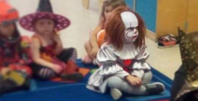 Kid dressed as It the clown