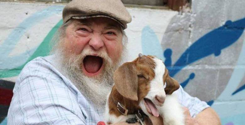Man overjoyed to be near baby goat