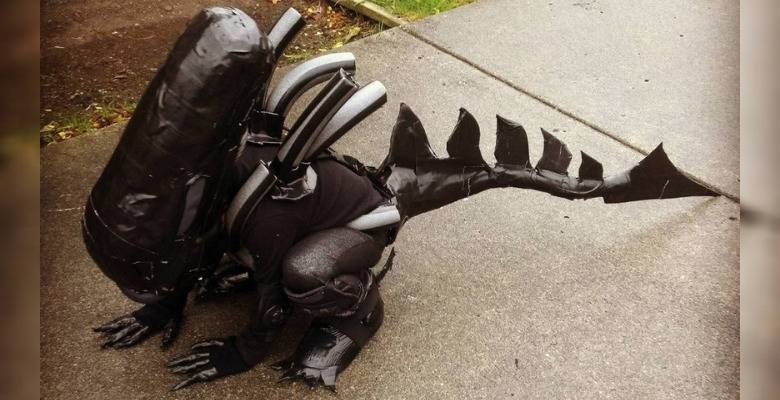 kid dressed as realistic Xenomorph from the Alien movies