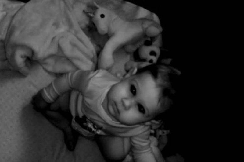 kid staring into a camera at night