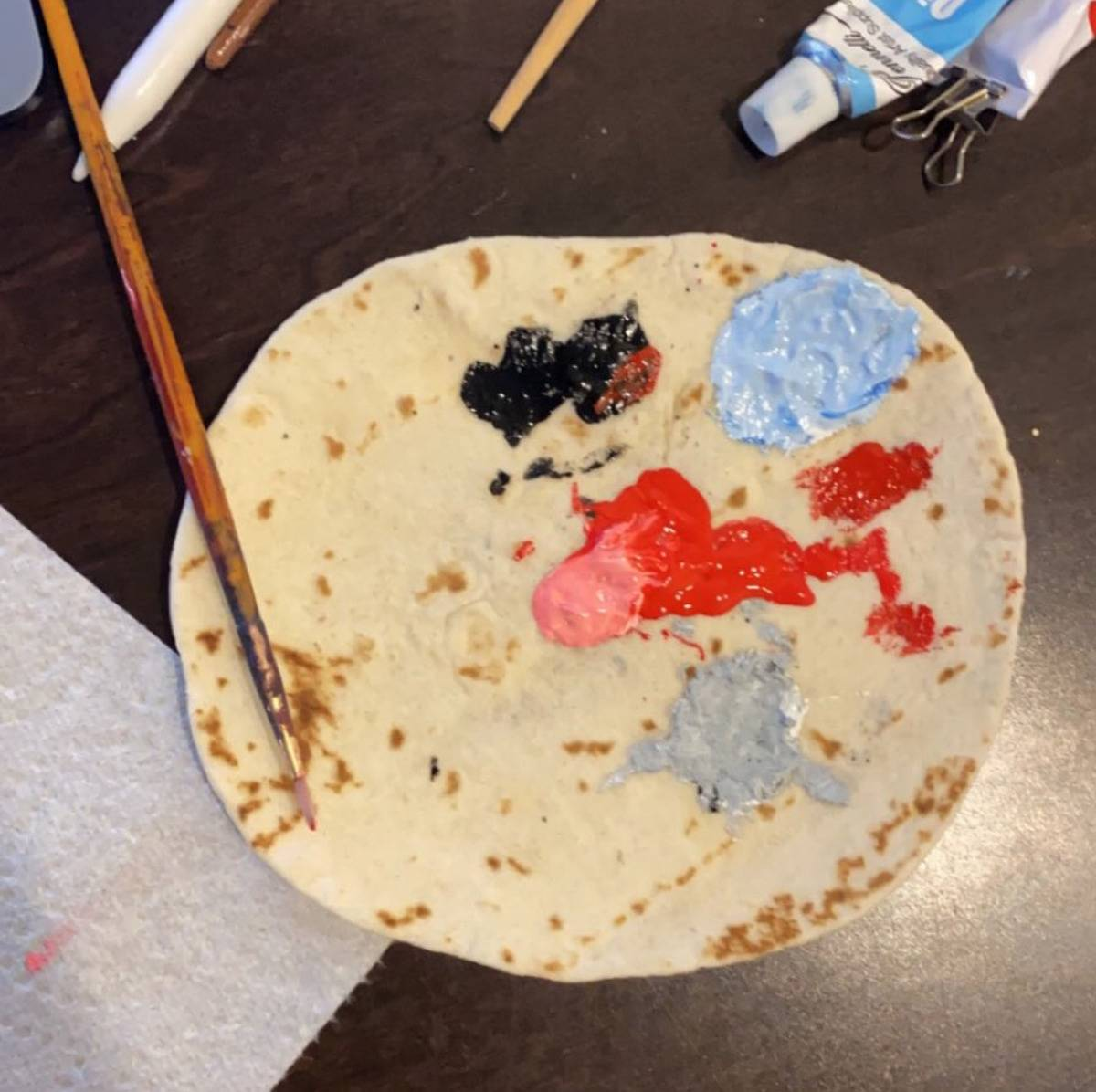 someone using a tortilla to put their paint on