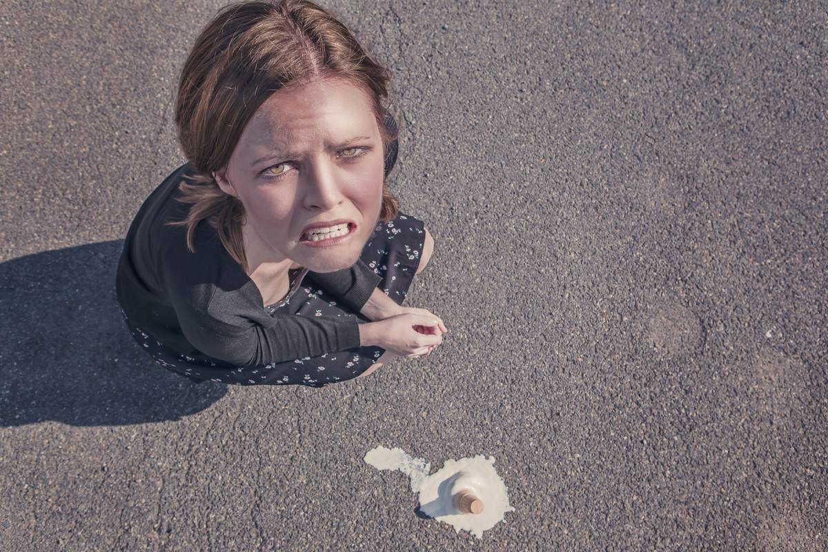 woman sad about spilled ice cream