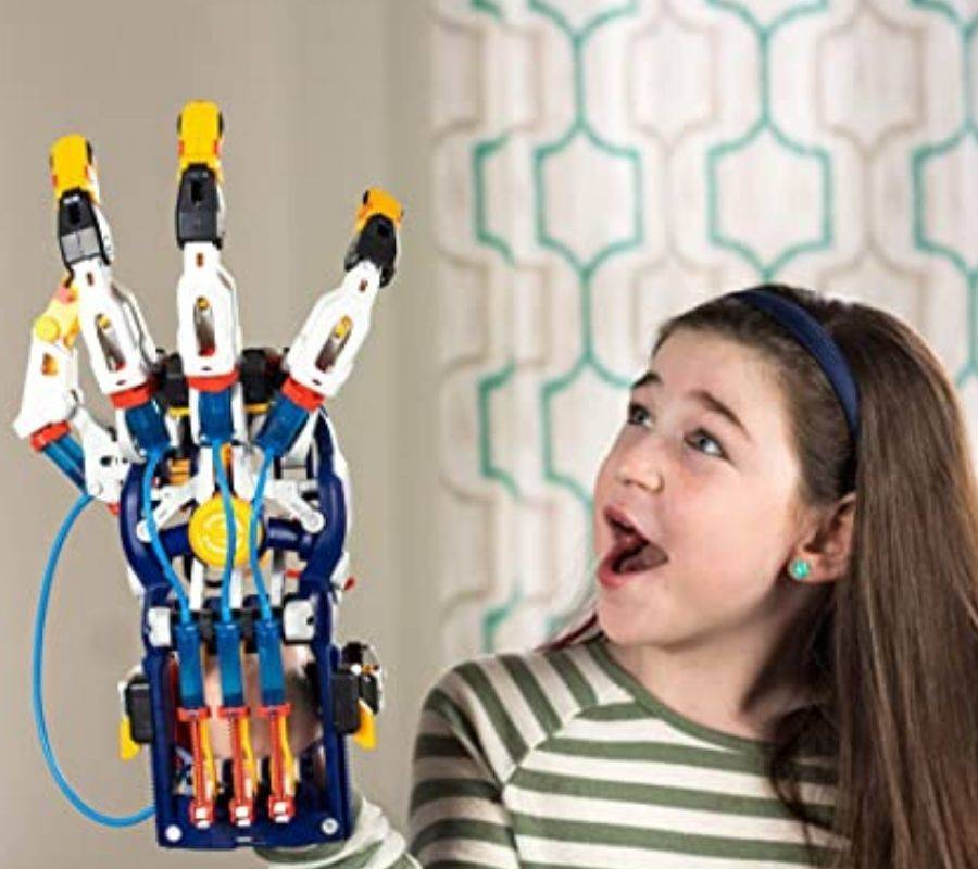 girl looking impressed at her Mega Cyborg Hand STEM Experiment Kit