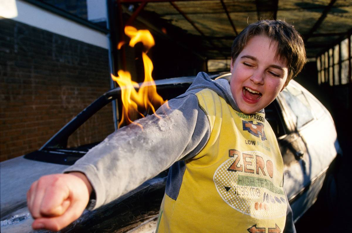 child with sweater sleeve on fire