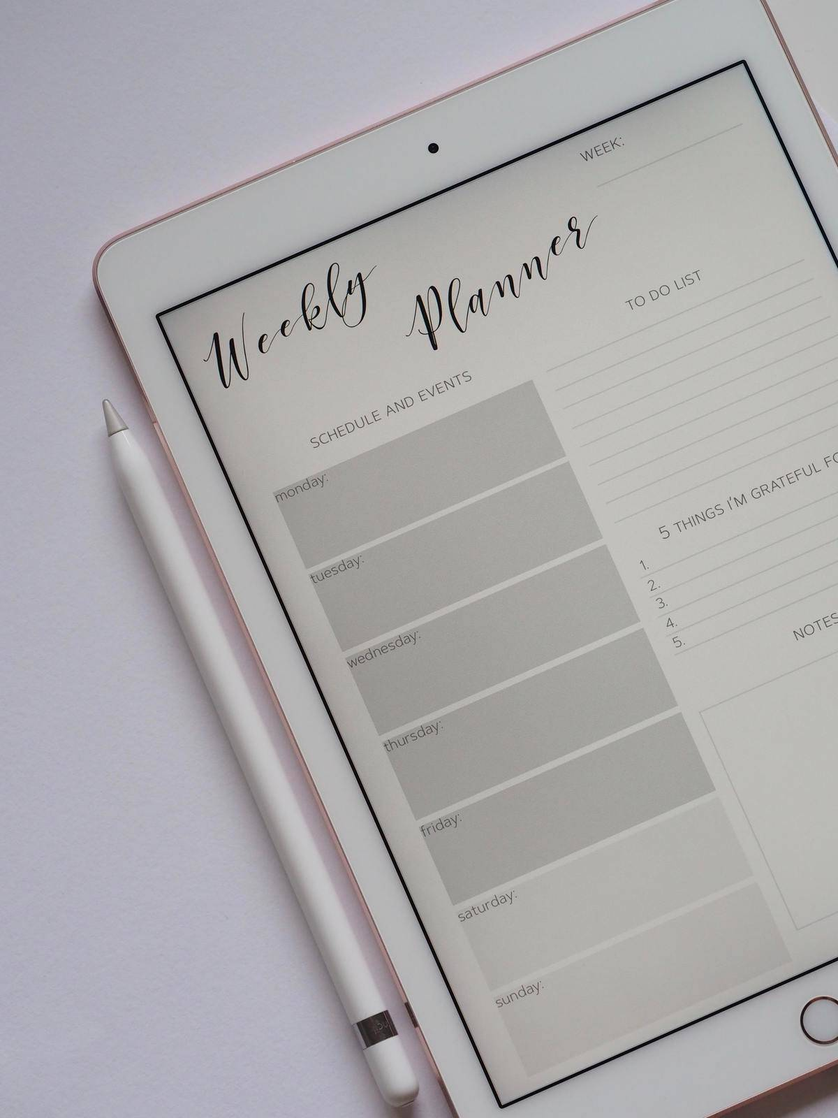 weekly planner open on ipad