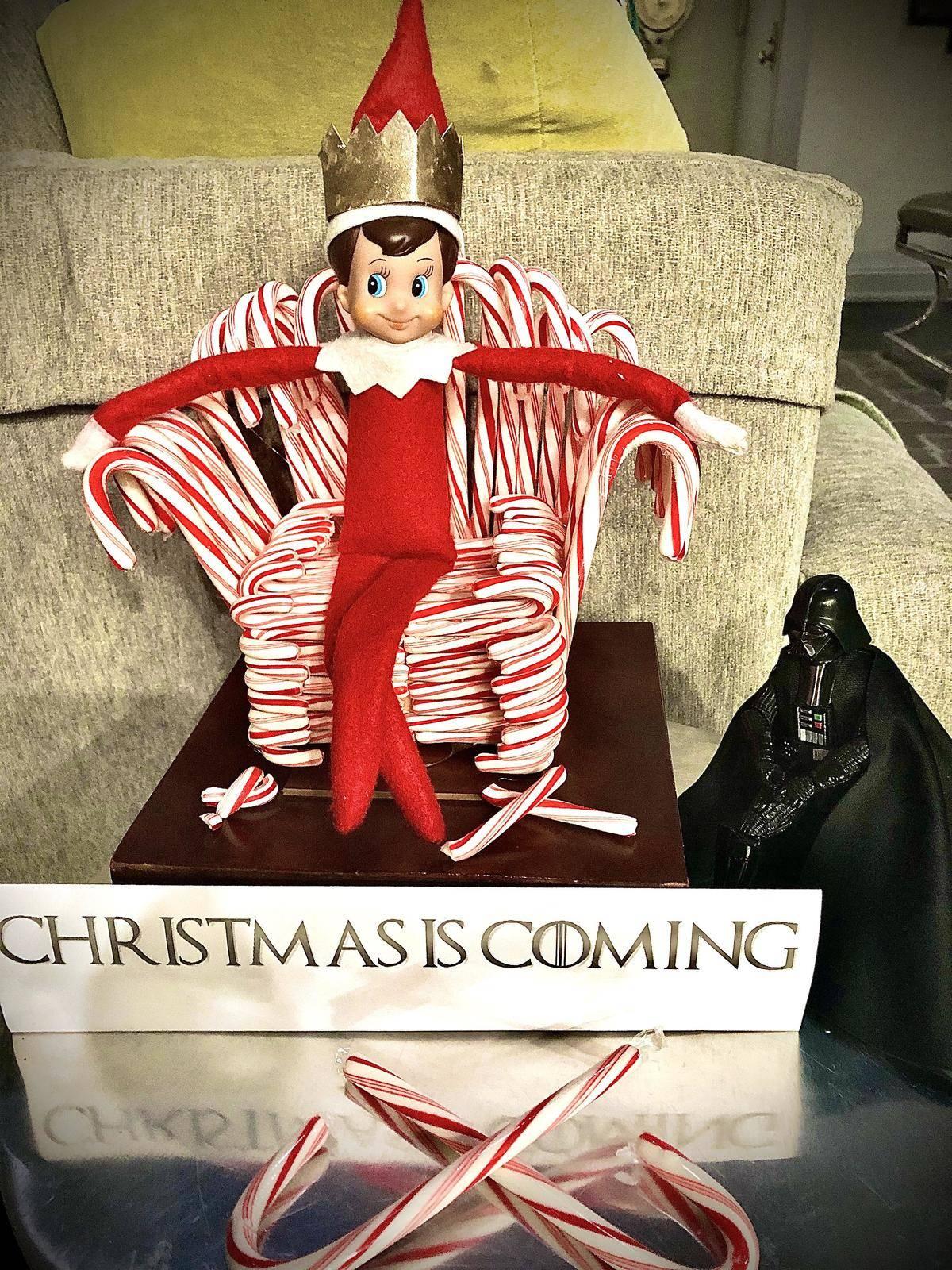 elf sitting on a candy cane throne