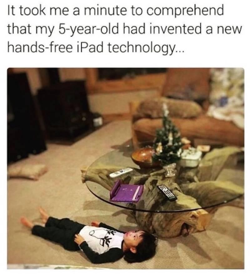 kid watching ipad under glass table