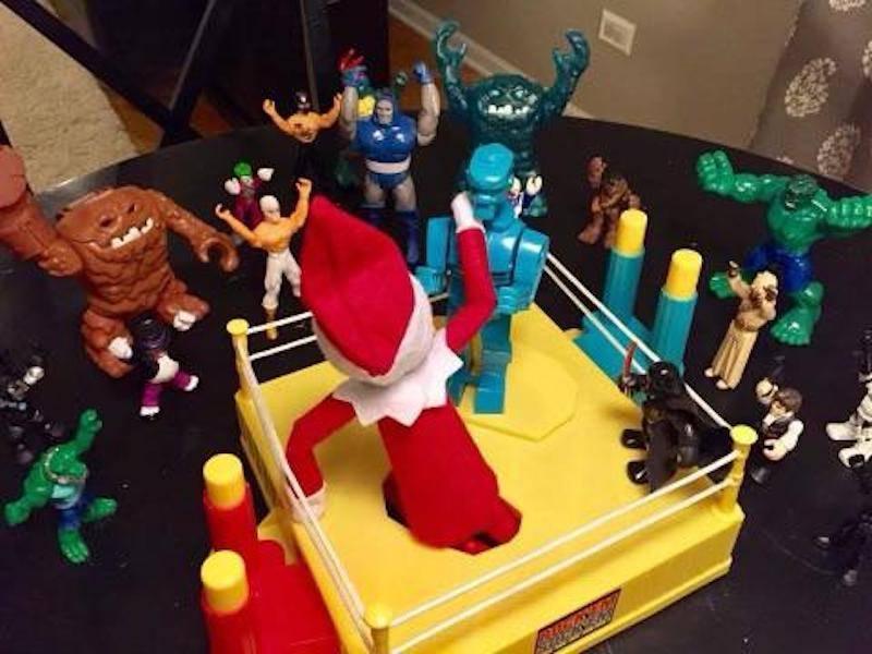elf on the shelf boxing a knock em sock em robot