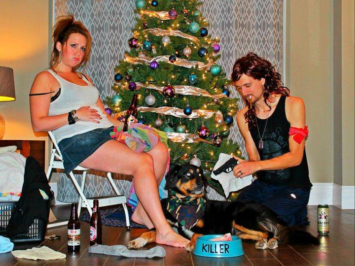 trashy christmas picture with man and woman and dog
