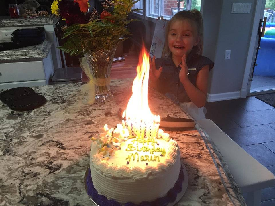 cake with many candles on fire