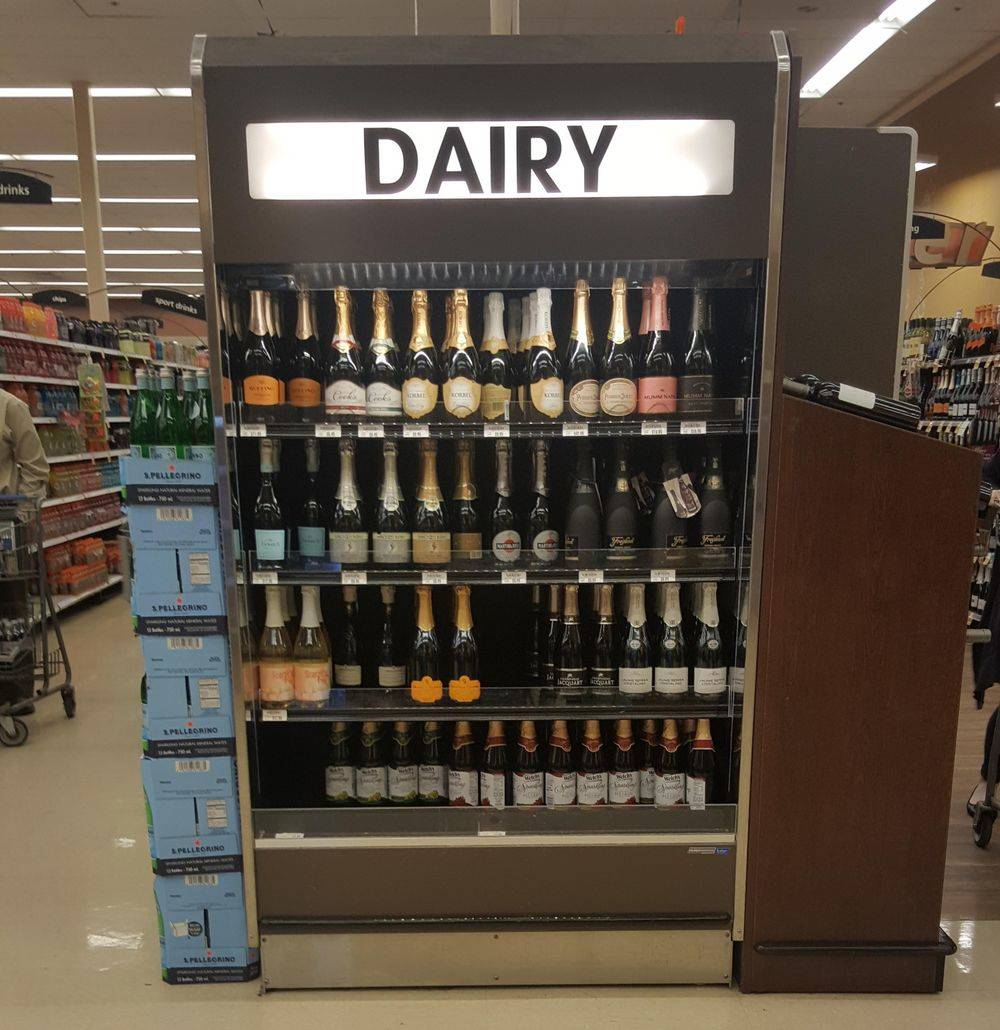 wine fridge in grocery store with
