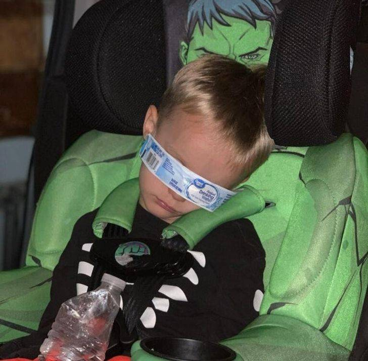 child sleeping with waterbottle wrapping on face