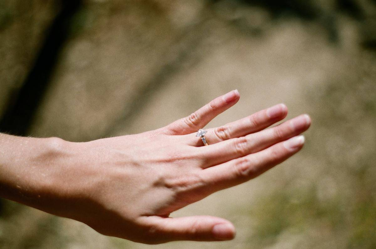 woman showing off engagement ring on left hand