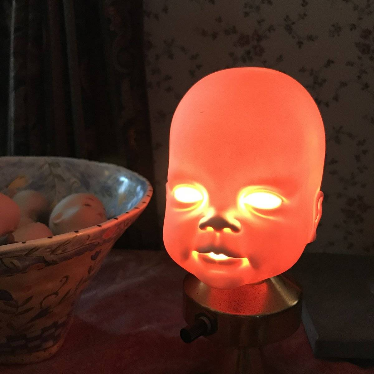 mom who turned doll baby's head into glowing lamp