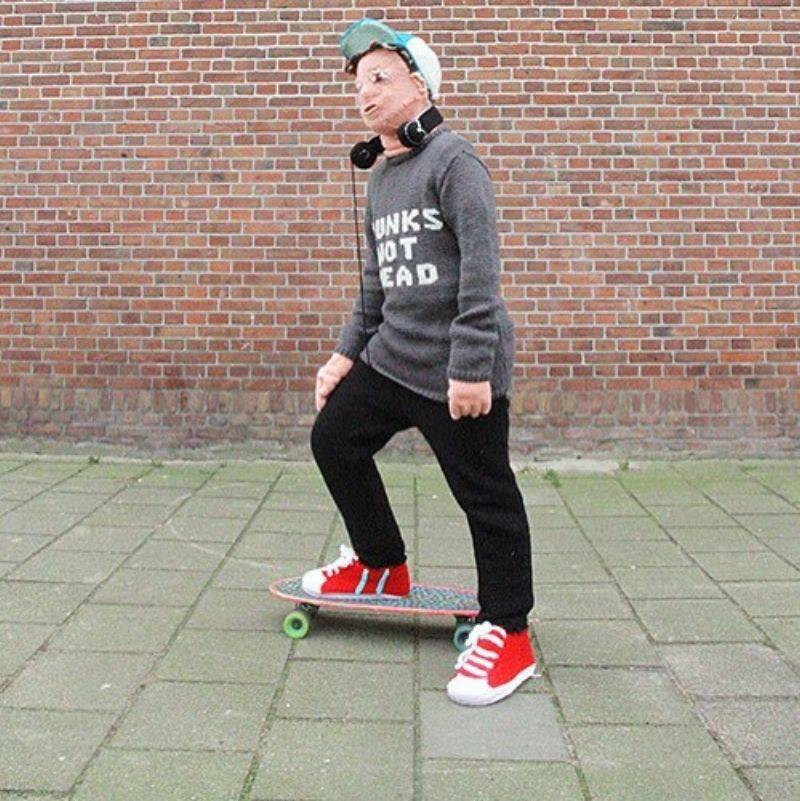 the knitted kid posed on a skateboard