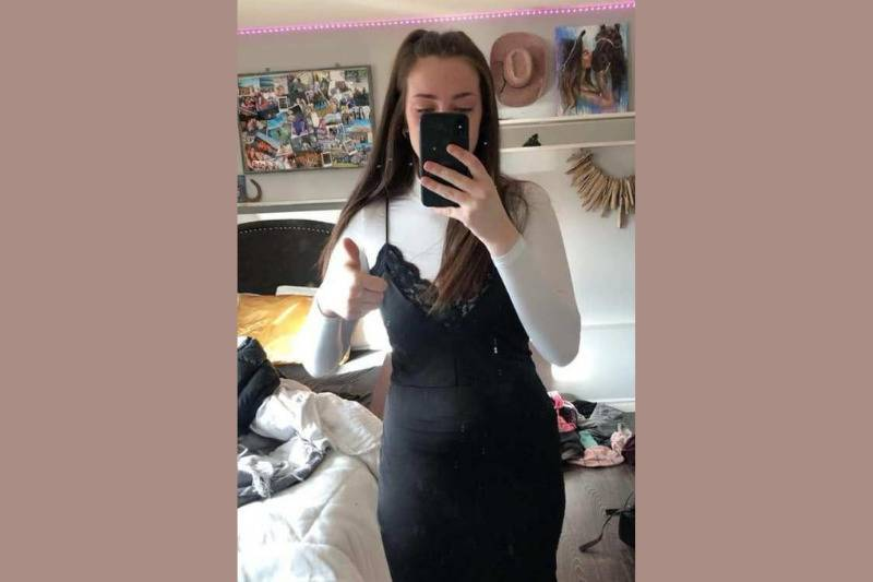 girl in black dress with white turtleneck