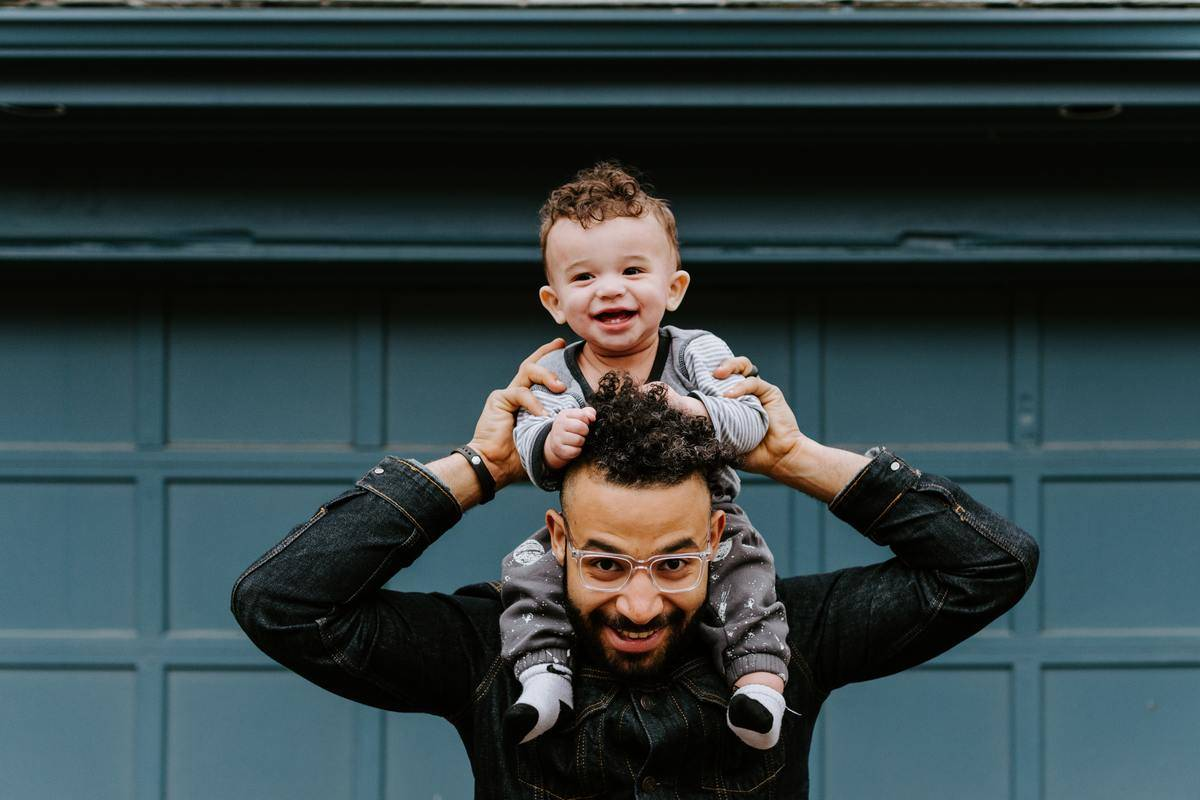 father with child on his shoulders
