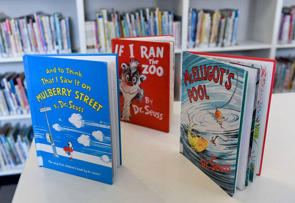 three Dr. Seuss books on a shelf with the titles,