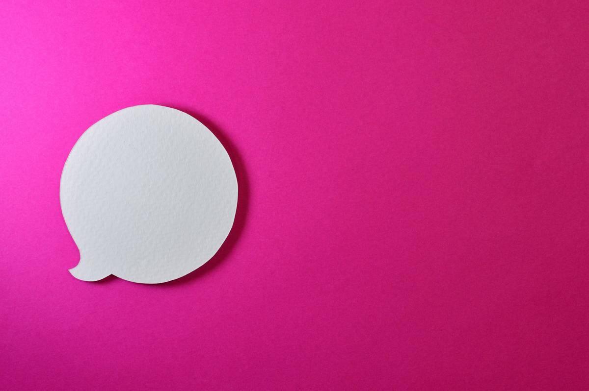 speech bubble on pink background