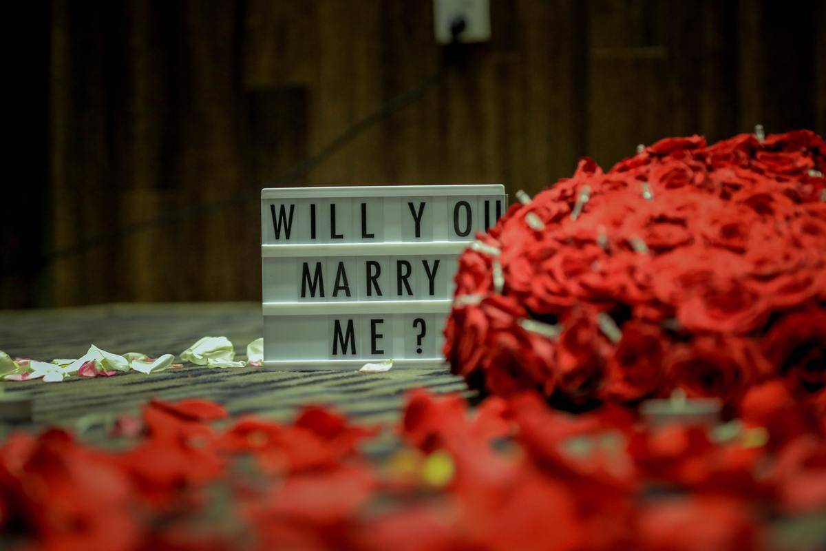 lightboard proposal sign that says Will You Marry Me