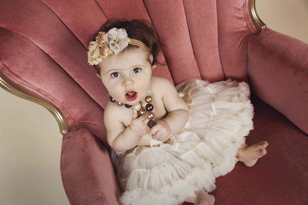 baby girl in tulle and floral outfit