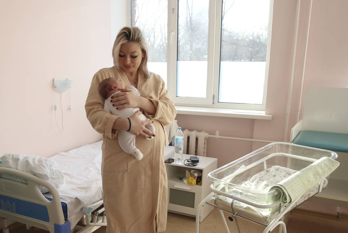 A woman holds a newborn at the maternity ward at the Khimki hospital.