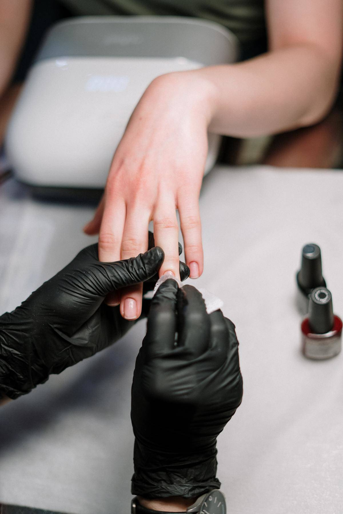 person getting their nails doned