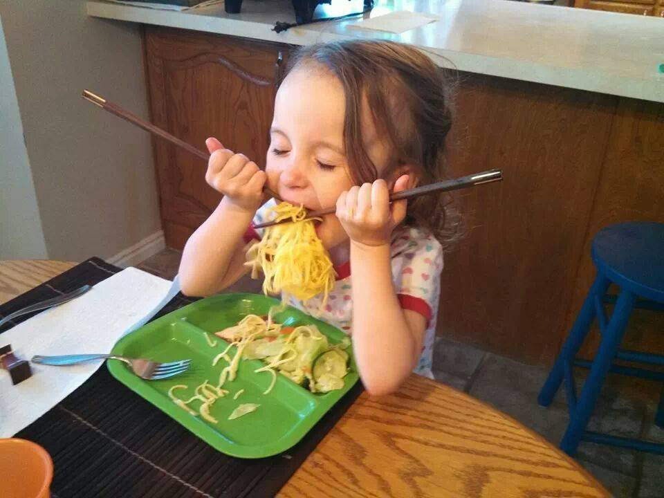 kid using chopsticks for the first time