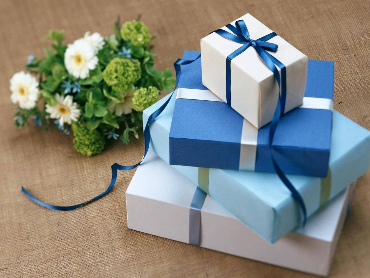 stack of blue and white wrapped presents