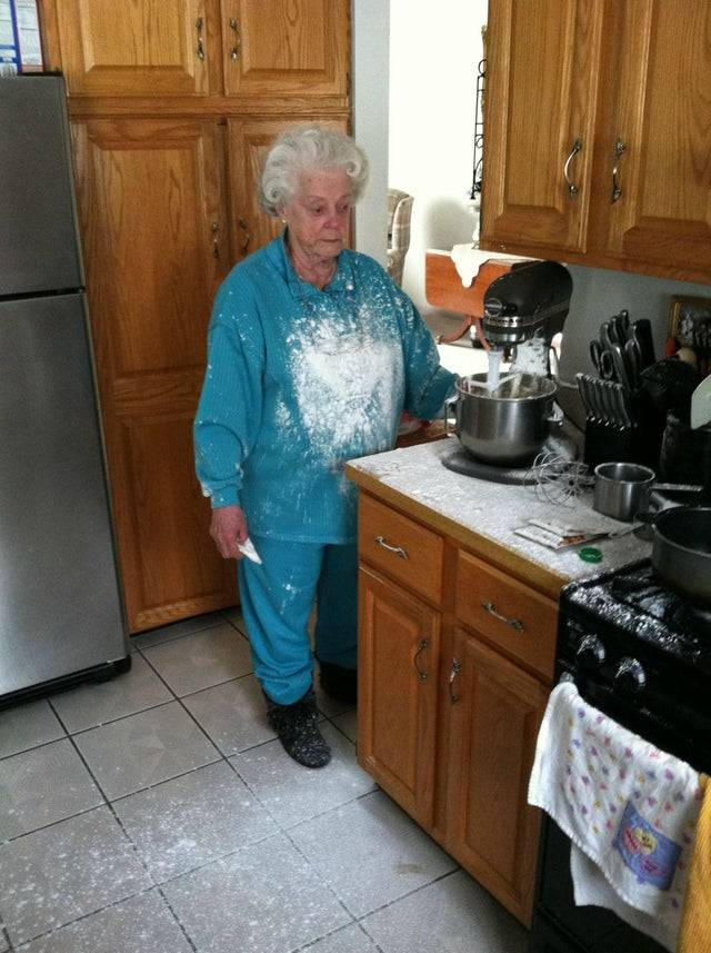 Mixer splatters powdered sugar all over an unsuspecting grandmother
