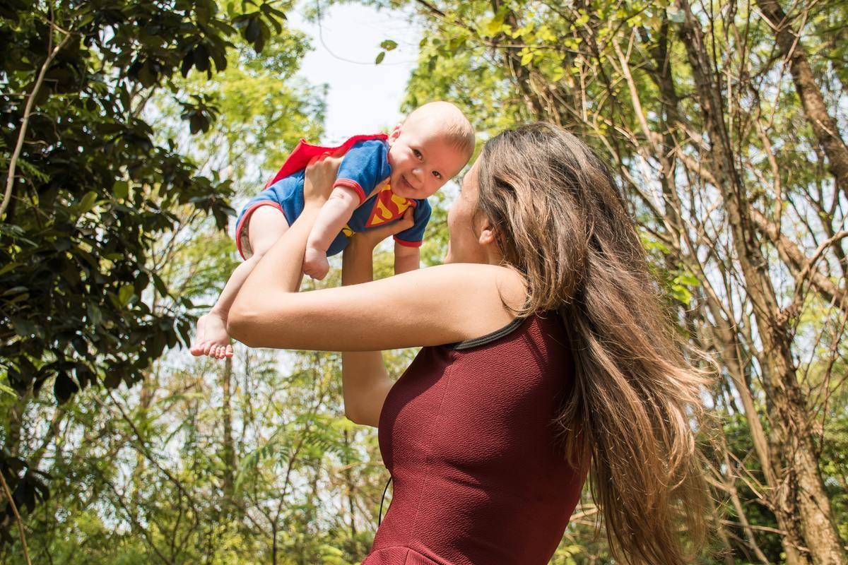 Happy Superman baby with mother