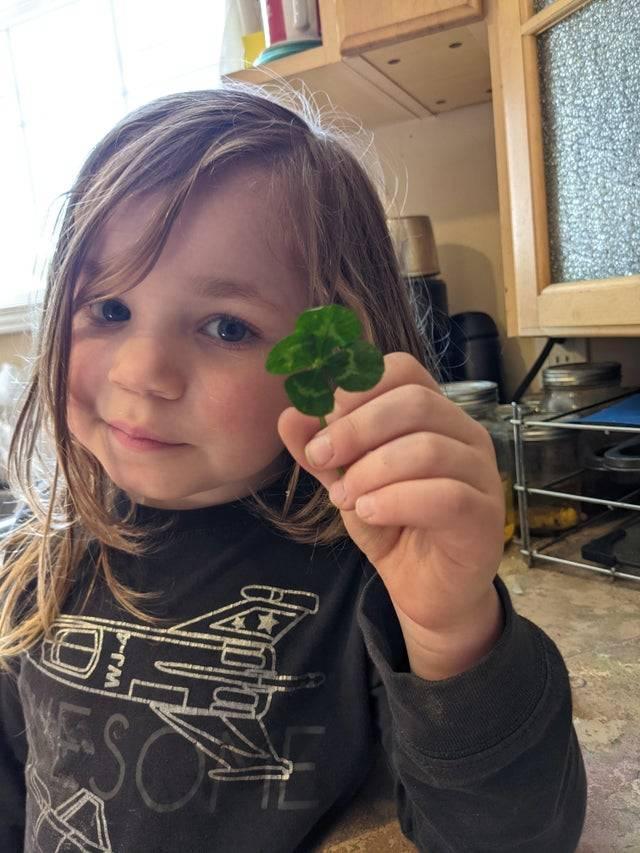 girl with four-leaf clover