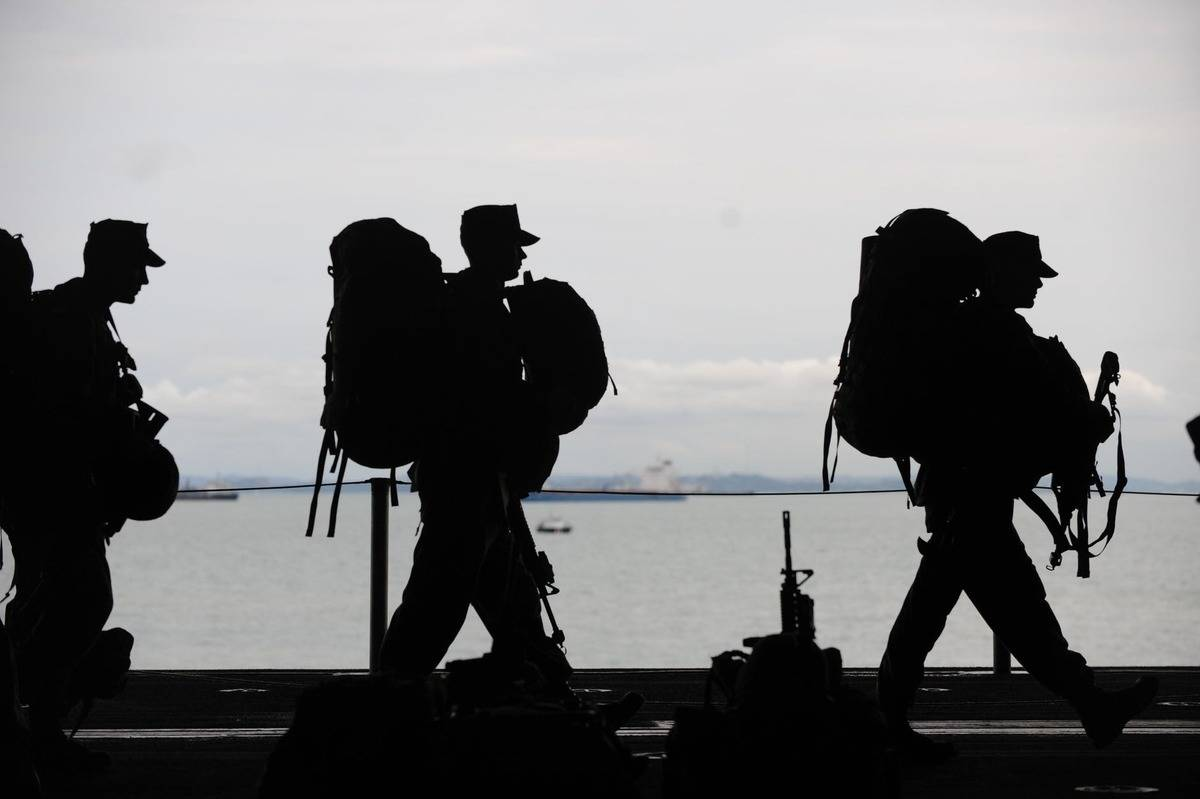 military men departing for service