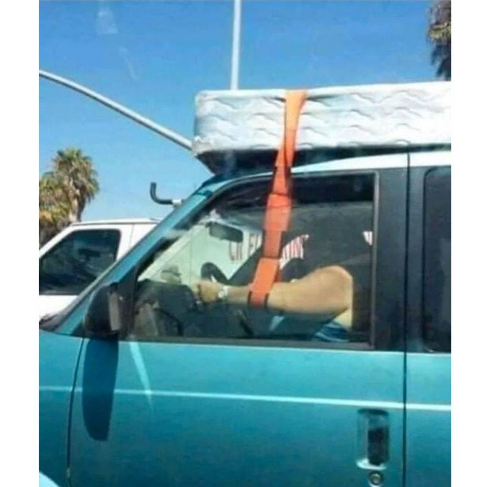 arm strapped to bed on roof