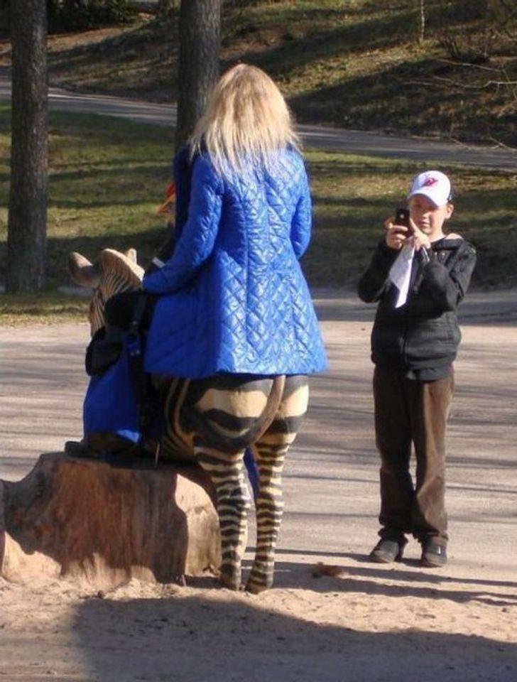 zebra lady taking a photo